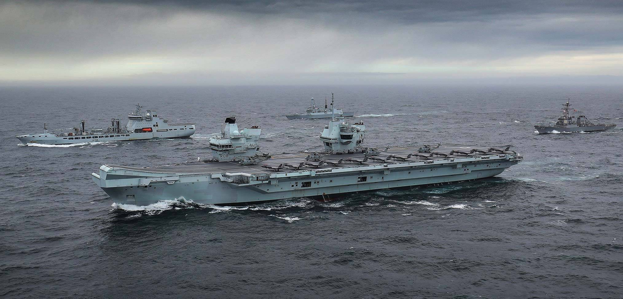 HMS Queen Elizabeth joined by supporting warships as the Carrier Strike Group assembles