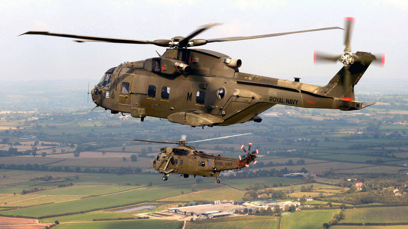 Merlin HC3 in formation with the Sea King Mk 4 it is replacing