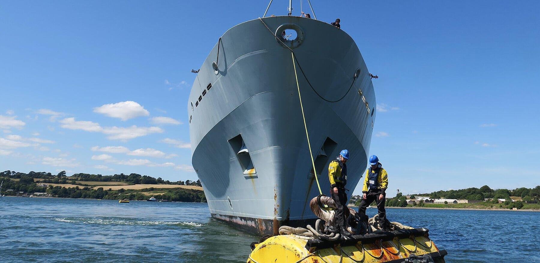 HMS Enterprise deammunitioning at bouy in Tamar
