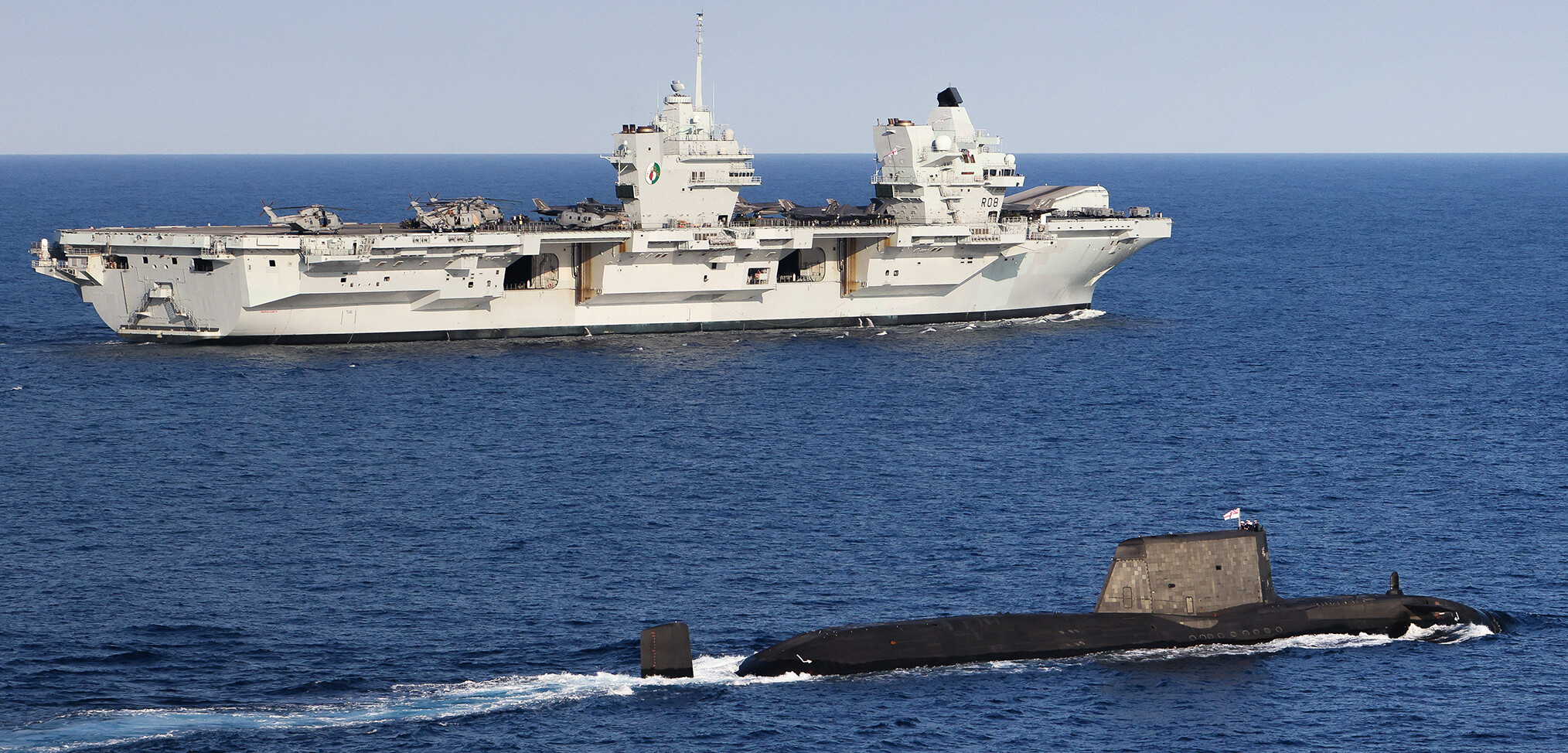 Meeting of the mighty. HMS Queen Elizabeth and her submarine consort